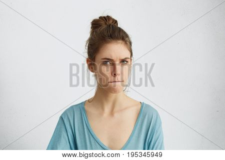 Serious Angry Woman Frowning Her Face Pressing Lips Togehter With Anger Trying To Control Herself An
