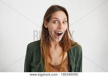 Embarrassed Young Beautiful Woman With Dyed Hair Looking With Opened Mouth And Surprised Eyes Isolat