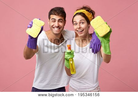 Attractive Cheerful Young European Male And Female Cheering After They Finished Cleaning Up The Room