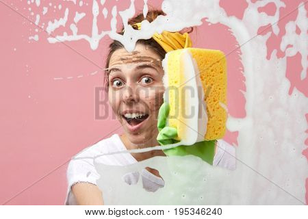 Portrait Of Funny Excited And Attractive Young Housewife Obsessed With Hygiene And Cleanliness Enjoy