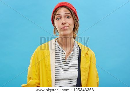I Don't Know. Headshot Of Doubtful, Uncertain Or Skeptical Young Caucasian Female In Colorful Clothe