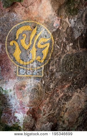 Royal Cypher Or Monograms Of Thailand King On Rock Wall