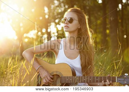 Beautiful Woman With Long Hair Wearing Sunglasses Looking Into Distance While Sitting At Greenland R