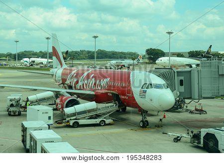 Airasia Airplane Docking At Changi Airport