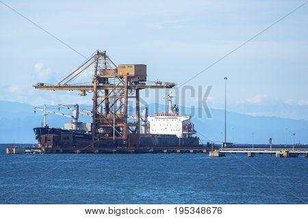 Labuan,Malaysia-June 26,2017:A large bulk carrier supplying iron ore in port of Labuan island,Malaysia.