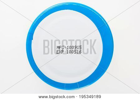 label expiration on bottle cap with white background