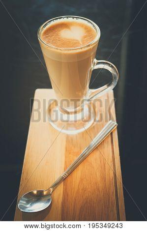closeup heart shape on latte coffee cup