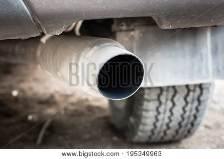 closeup exhaust pipe of car. reduce pollution  for the world