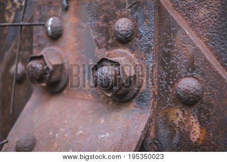 rust rusted rusty screw and nut on steel beam closeup