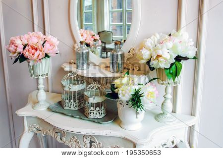 Boudoir table mirror with flowers. The morning the story of the mirrors in the interior.
