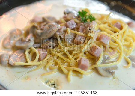 Spaghetti With Mushroom Sauce On Black Dish