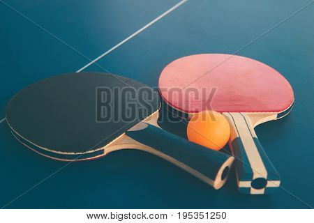 Tabletennis Or Ping Pong Rackets And Balls On Table. Sport Concept