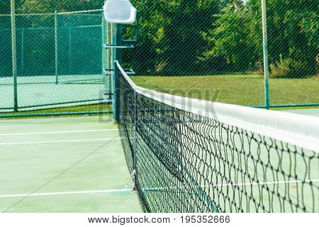 Outdoor tennis court, no green grass field.