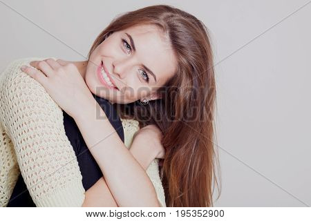 Portrait of a beautiful girl with long hair in a yellow dress