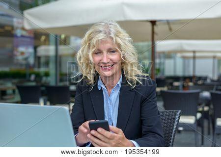 Smiling Happy Senior Businesswoman