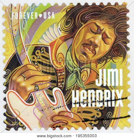 LUGA RUSSIA - APRIL 26 2017: A stamp printed by USA shows image portrait of James Marshall Jimi Hendrix - an American rock guitarist singer and songwriter circa 2014
