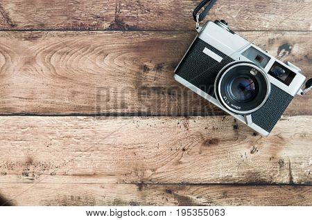 Old 35mm film camera camera on wooden desk