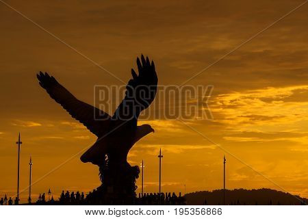 Silhouette Of Majestic Eagle Statue In Langkawi During Beuatiful Golden Sunset.