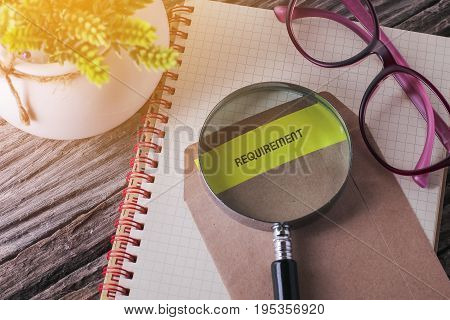 Business Concept : REQUIREMENT written on envelope with wooden background poster