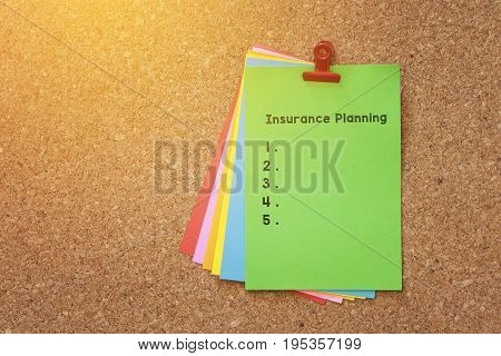 Insurance Planning Written On Color Sticker Notes Over Cork Board Background.