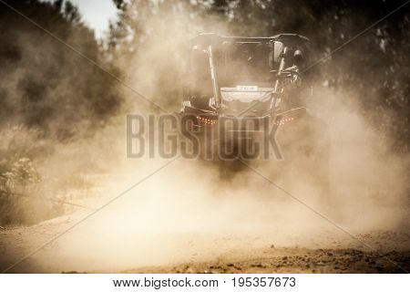 Back View Of Buggy Riding Along A Country Road.