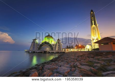 Blue Hour At Beautiful Malacca Straits Mosque With Moon At Background.
