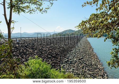 The rock wall of Queen Sirikit Dam in Uttaradit Province, Thailand, in perspective view
