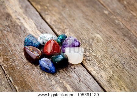 Cluster Of Colorful Healing Crystals On Textured Wooden Background