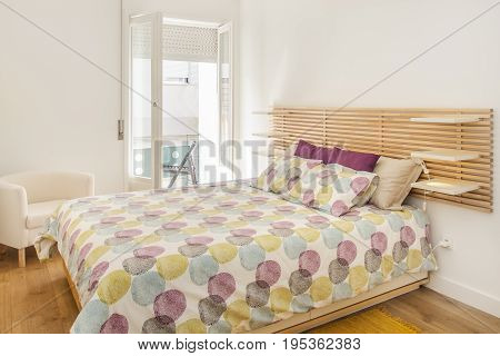 A Bright Bedroom Suite with Hardwood Floors