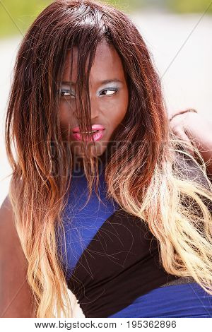 Beautiful african black woman with glamorous long hair