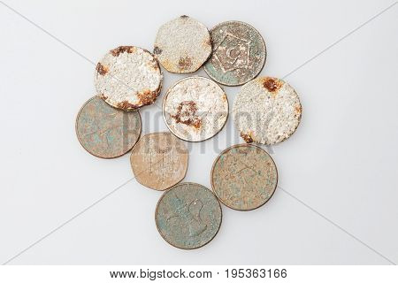 Antiques. Vintage iron coins isolated on white background poster