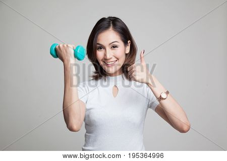 Healthy Asian Woman Thumbs Up With Dumbbells.