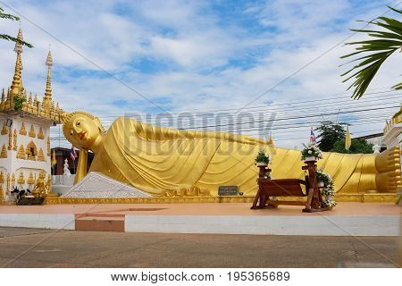 Phrae Thailand - December 15 2016: The golden Reclining Buddha statue at Wat Phong Sunan or Phong Sunan Temple Phrae Province North of Thailand.