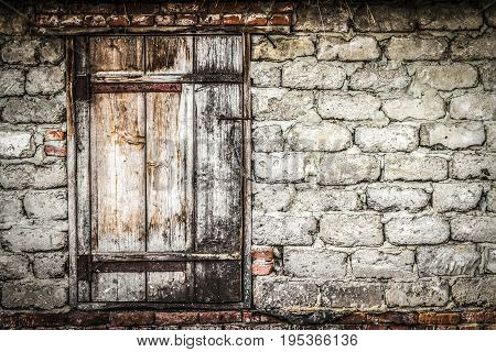 Old wooden door in rural barn closeup.