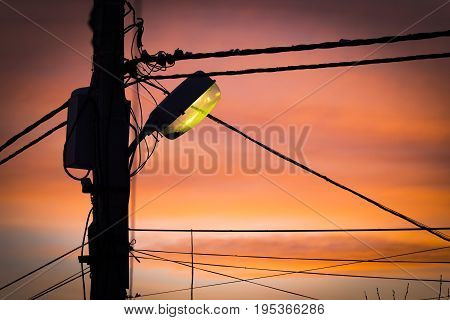Glowing lights on the pole at dusk.