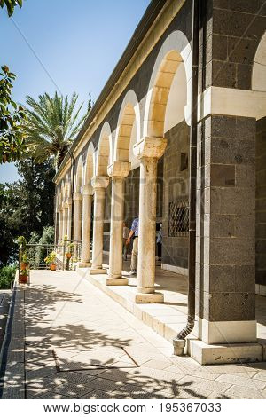 Church of Mount of Beatitudes marble columned gallery near Sea of Galilee in Israel