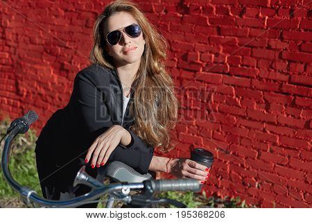Attractive successful happy eco-friendly European businesswoman in formal wear enjoying city ride on retro bicycle cycling home after working day at office feeling relaxedcarefree looking at camera