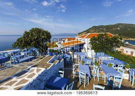 SKOPELOS, GREECE - JUNE 14, 2017: Restaurant on the castle hill in Skopelos town, Greece on June 14, 2017.