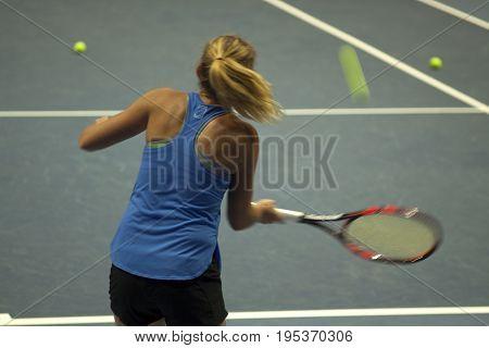 Tennis Player, Fast Movement, Defocus.