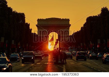 Traffic Jam In Paris On Champs-elysees Street With Triumphal Arch