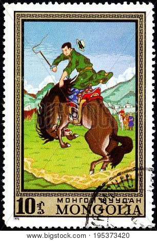 UKRAINE - CIRCA 2017: A postage stamp printed in Mongolia shows Taming Wild Horse from the series Paintings by contemporary artists in Ulan Bator Museum circa 1972