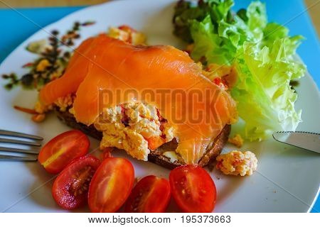 Tasty Morning Breakfast, Omelet, Salade, Salmon And Tomates