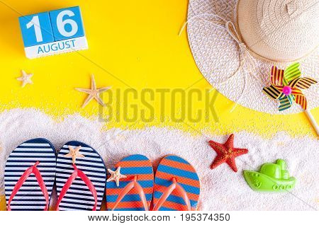 August 16th. Image of august 16 calendar with summer beach accessories and traveler outfit on background. Summer day, Vacation concept.
