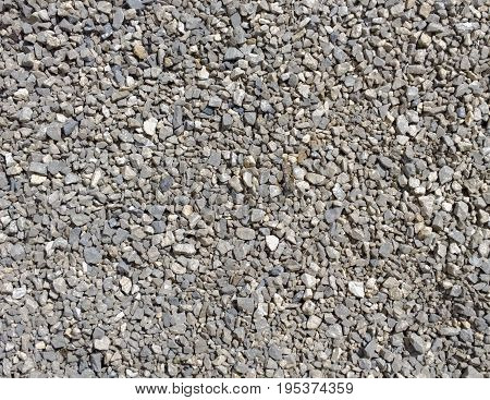 Crushed stone texture. Small stones background. macadam poster