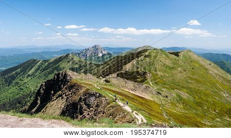 panorama of Krivanska Mala Fatra mountain range with Hromove Steny Poludnovy grun Stoh Velky Rozsutec and Maly Rozsutec hill from Chleb hill summit in Slovakia