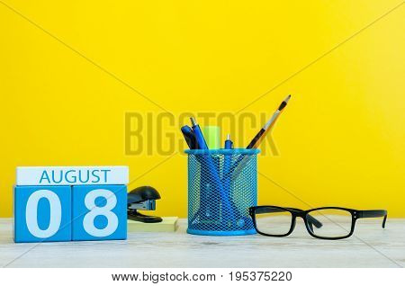 August 8th. Image of august 8, calendar on yellow background with office supplies. Summer time.