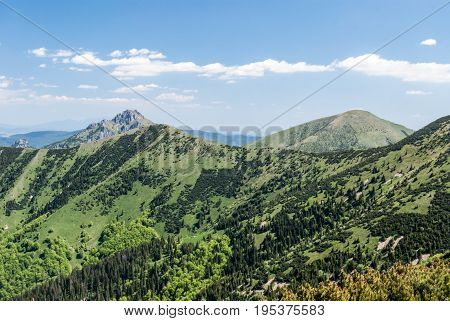 panorama of Krivanska Mala Fatra mountain range with Stoh Steny Velky Rozsutec and Maly Rozsutec hills during hiking from Snilovske sedlo pass to Chleb hill above Vratna dolina valley near Terchova resort in Slovakia