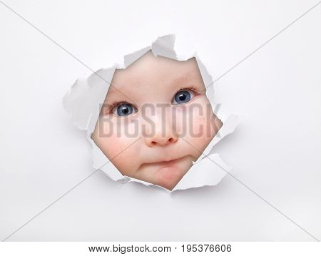 Picture the face of a little boy in a paper hole