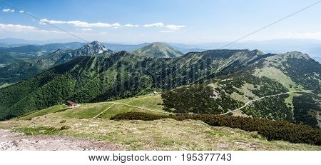 spectacular mountain panorama with Mala Fatra main ridge from Chleb to Maly Rozsutec hill from highest hill of Mala Fatra mountains - Velky Krivan - during spring day with blue sky and only few clouds