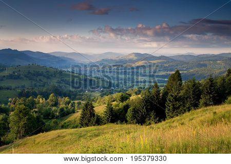 Beautiful summer sunrise in Bucovina village, Romania